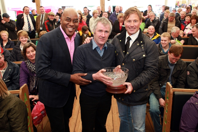 Brendan Starkey receiving his prize from Ainsley Harriott, Celebrity Chef and Jim Viggars from ASDA