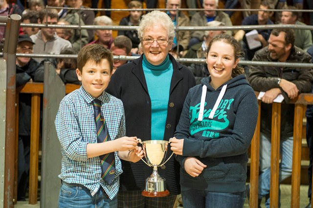 Christine, Ellie and Angus McClymont collecting the Willie Davidson Memorial Trophy for best pen of commercial Salers